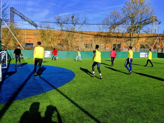 Children from the All4One youth group play football
